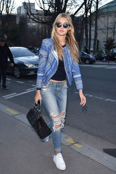 Gigi Hadid.. IRO Ozaka Jacket, Joe's Slouched Jeans, Adidas by Raf Simons Smith Sneakers, and D&G Miss Sicily Satchel..