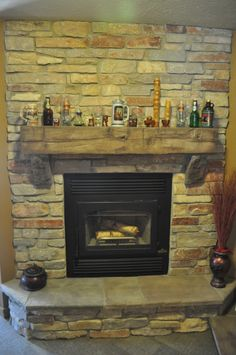 Stones Fireplace with Barn Beam Mantle and Natural Stone J&N Stone