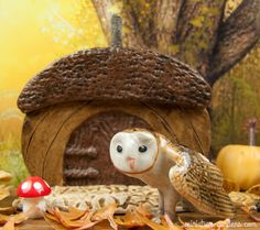 Our mini owl poses in front of our acorn fairy door in the fall fairy garden.