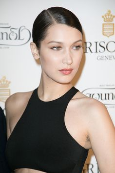 sleek hair parted at the side on Bella Hadid