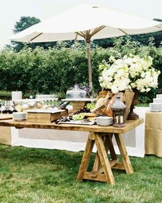 this is rustic and beautiful too ... we could get two wooden horse stands and lay wood over top