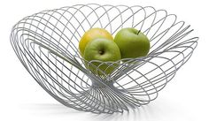 I love the shape of this bowl! It is very very eye-catching and something that would make a great edition to the kitchen, it is a piece of art but it is also has a purpose and it fulfills that purpose, i like the way its been curved and twisted.