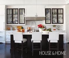 Glamorous Black & White Kitchen - shaker cabinetry, contrasting cabinet doors with glass inserts.