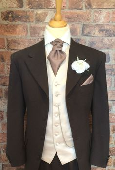 A classic brown herringbone wool Edwardian jacket, with matching trousers. This mid thigh length jacket is the perfect alternative to a Tailcoat. Recommended to be worn unbuttoned, displaying the waistcoat beneath. Wedding Hire, Wedding Men, Wedding Suits, Morning Suits, Groom Tuxedo, Hawaii Wedding, Wedding Makeup, Formal, Brown