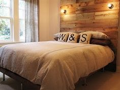 another lovely rustic headboard... the lights are a cool addition!