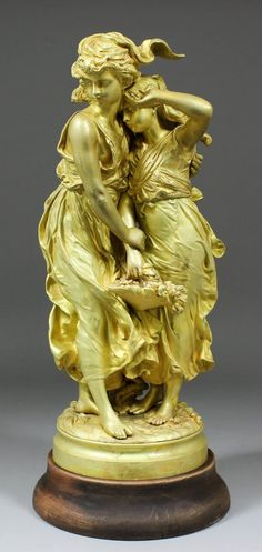 """Lot: A 19th Century French gilt bronze figure after Moreau depicting two lightly draped women carrying a basket of flowers. Height : 17.5"""""""
