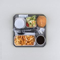 This airline meal only looks good when you're trapped on a long fligh by Suzanne Clements #stocksy #realstock #food