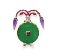 AN ART DECO JADE, AMETHYST, RUBY, DIAMOND, PLATINUM AND GOLD BROOCH, BY CARTIER - circa 1925
