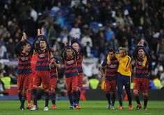 FC Barcelona players celebrate after beating 4-0 during the La Liga match between Real Madrid and Barcelona at Estadio Santiago Bernabeu on November 21, 2015 in Madrid, Spain.