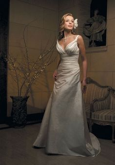 Casablanca Bridal -- I love the top of this dress!  Gown features beading.  Silhouette: A-Line Neckline: V-Neck Waist: Empire Gown Length: Floor Train Style: Attached Train Length: Chapel Sleeve Style: Spaghetti Straps Fabric: Silky Taffeta Embellishments: Beading Color: White or Ivory