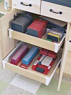 Stash It  Pull-out drawers make it easy to hide your supplies and easy to retrieve them when needed. Here the die cuts are organized vertically to use less space. Simply use wood dividers to customize your drawers.