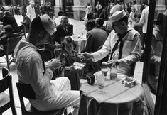 Naples. 1948. Angela sells cigarettes which she gets from the Black Market, to people at the cafes.