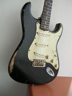 1962 Fender Stratocaster in black.  Gorgeous guitar, worn in all the right ways