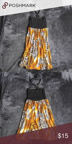 646 Main Summer Dress Animal print skirt and beaded tie around neck straps. Great condition. Never worn.  95% Polyester 5% Spandex 646 Main Dresses Midi