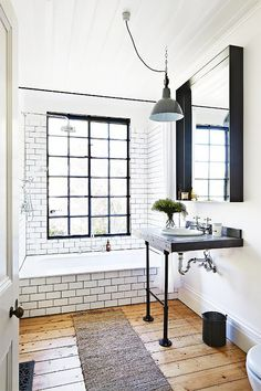 If bright and bold interiors aren't your style, this stripped-back monochrome look will do the trick. With signature subway tiles and industrial hardware, this space looks chic (and will for years to come).