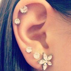 multiple ear piercings  earrings - i need to get my ears to look more like this..
