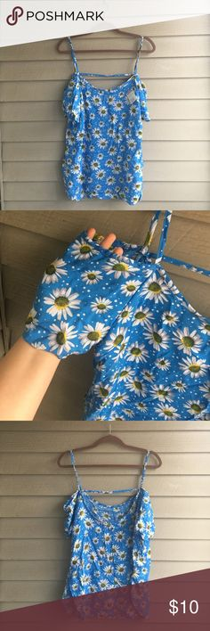 💙 cute blue daisy tank I'm selling a super cute blue tank with daisies on it. The very short sleeve has an opening on the shoulder which is very cute. New with tags, never worn. It's a juniors 1X Tops Tank Tops