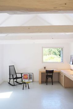 An old barn has been converted into an artist studio in Brittany by Modal Architecture