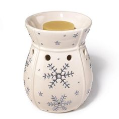 """Opening at back to fit tea light candle (not included). Use with our wax melts (sold separately). 4 1/8"""" diam. x 5 3/4"""" H. Ceramic, stone. Imported."""