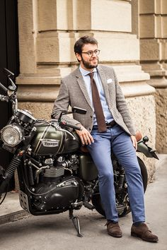 Yea yea yea, the outfit is nice but that Triumph Scrambler is boss.  Boss I said!