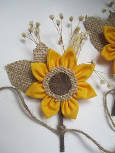 Found via @laurag314 (Laura Gibbons). Rustic wedding fabric flower sunflower boutonnieres by darlyndax on Etsy.