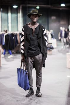 Nicely proportioned and layered styling with modern folk influences. WGSN street style from the Berlin trade shows