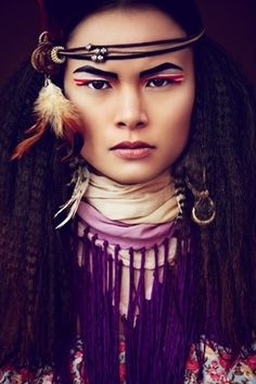 """American Indian. makeup, accessoire"">>> OH whats so ""American Indian"" about this?? Because the model ""LOOKS"" Native or because of the ""tribal"" accessories- fedder, pleather, and lil scarf that resembles a dance shawl? FUCK YOUR STEREOTYPING!"