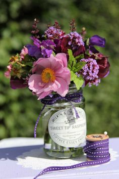 jam jar posies flower arrangements late summer wedding table decorations cottage flowers