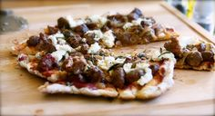 recipes for grilling pizza: lamb and garlic sausage pizza with fresh sage, caramelized onions, and goat cheese