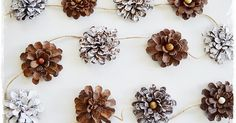 PINE CONE FLOWERS...LOVE!  This is such a pretty DIY!  I love that this simple garland is an easy one!All you need are pine cones, some f...