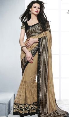 Give a new dimension to your appearance in this beige art silk, crepe and net saree. The floral patch and sequins work seems to be chic and great for any celebration. Upon request we can make round front/back neck and short 6 inches sleeves regular sari blouse also. #AwesomeTikkiWorkSareeCollection
