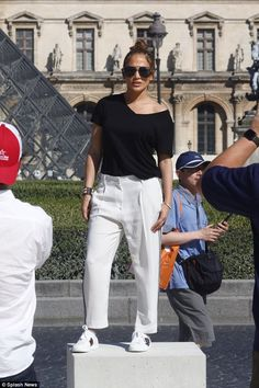Strike a pose: The couple added a touch of culture to their Parisian holiday when the coup...