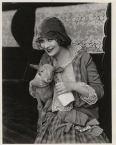 Dolores Costello ready to feed a little lambikins.