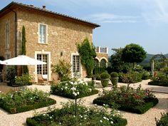 Formal garden at the Borgo Santo Pietro hotel in Tuscany