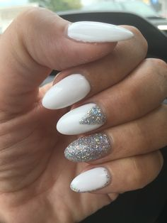 White nails with silver glitter design