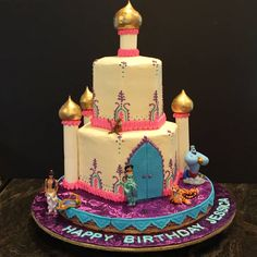 Jasmine Aladdin birthday cake using purchased figurines. Cake is buttercream with fondant doors and pillars.