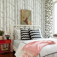 One of my favorite decorated bedrooms!  I absolutely love this wallpaper, love big antlered bucks, white bedspreads, and my favorite pops of color are coral and b & w combo.  So I really love, love, LOVE, this room!!