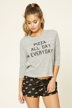 "A PJ set featuring a burnout knit tee with 3/4 sleeves, a ""Pizza All Day Everyday"" graphic on the front, and a round neckline, as well as a pair of woven cotton shorts with an allover pizza print and an elasticized drawstring waist."