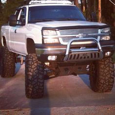 oh my!! <3<3<3<3<3<3<3 one day i will have my white jacked up truck! Hopefully sooner than later ;)   www.dieseltees.com #duramax #jackeduptruck #dieseltees