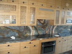 Blue Louisa granite countertop and backsplash. Very intense mix of colors, works wonderfully with tan or dark red cabinets. Blue Granite Countertops, Outdoor Kitchen Countertops, Granite Colors, Granite Kitchen, New Kitchen, Granite Backsplash, Van Gogh, Kitchen Interior, Kitchen Decor