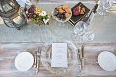 Antique-Inspired Tablescape  Photography: Joy Marie Photography Read More: http://www.insideweddings.com/weddings/fairy-tale-outdoor-summer-wedding-at-a-vineyard-in-wine-country/1104/