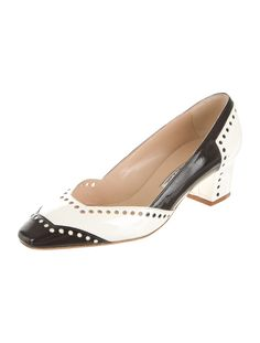 Black and white patent leather square-toe pumps with tonal stitching throughout and covered heels. Includes box and dust bag.