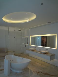 Structural Fixture: Strip Lighting: This bathroom has an accent light of fixed strip lights.  The mirror and circular ceiling indent are both accented.