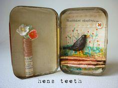 altered tin artwork by hens teeth, via Flickr