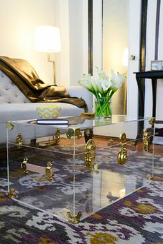 A clear trunk coffee table is chic and glamorous, without creating visual clutter.  Perfect for small apartments.