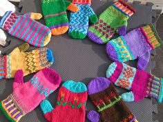 Ravelry: Color Me Warm Mittens pattern by Colleen Brooks. Adult sizes, but the photo is good inspiration.