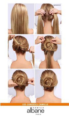 Le Twisted bun, step by step :  1. Appliquer de l'eau texturisante sur vos cheveux et les lisser ensuite. 2. Diviser en deux partie égales vos cheveux. 3. Réaliser un nœud avec ces deux nattes et fixer à l'aide d'épingles. 4. Twister et enrouler l'une des mèches autour du nœud. 5. Répéter l'opération avec l'autre mèche de cheveux que vous enroulerez cette fois-ci dans le sens opposé. 6. Cacher les bouts des mèches restantes sous le bun et terminer avec de la laque !