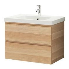 "GODMORGON / ODENSVIK Sink cabinet with 2 drawers - white stained oak effect, 31 1/2x19 1/4x25 1/4 "" - IKEA $299 Smooth-running drawers with pull-out stop.You can easily change the size of the box by moving the divider. Drawers pull out fully. Drawers made of solid wood, with bottom in scratch-resistant melamine.The included water trap is easy to connect to the drain, washing machine and dryer because it is flexible.Unique water trap design gives room for a full sized drawer."