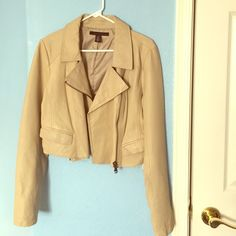 Kenneth Cole New York Leather Jacket A beautiful tan/cream leather jacket that's only been worn twice! The jacket is in excellent condition with two barely noticeable marks (noted in the pictures). They jacket actually came with the marks on it. Looks amazing with jeans and dresses. A lovely staple for any wardrobe! Kenneth Cole Jackets & Coats