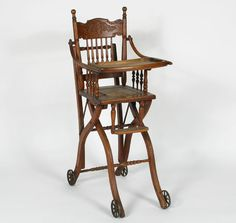 Antique high chair that converts to a stroller.